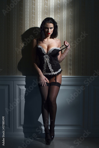 Sensual brunette woman at night