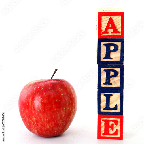 Red apple and ABC blocks isolated on white
