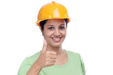 Smiling female architect with thumbs up gesture