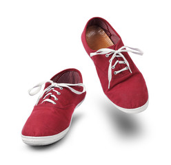 Red sneakers dancing isolated