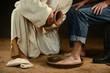 Leinwanddruck Bild - Jesus Washing Feet of Man in Jeans