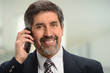 Portrait of Hispanic Businessman Using Cell Phone