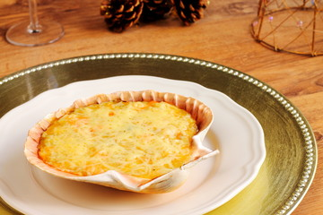 Stuffed scallop shell on a Christmas table