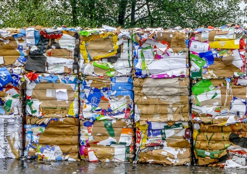 Bales of crushed compressed paper and cardboard for recycling