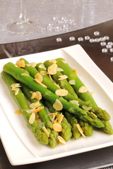 Roasted asparagus with almonds on a Christmas table