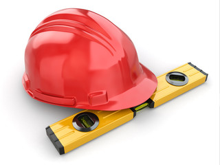 Construction concept. Hardhat and carpenter's level.