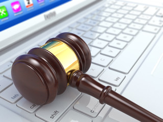 Online judgement. Gavel on laptop.  3d