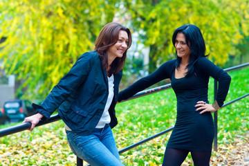 two woman friends outside