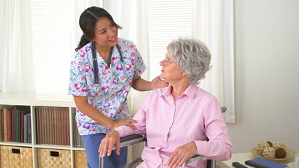 Japanese nurse talking with patient