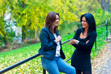 two woman friends outside