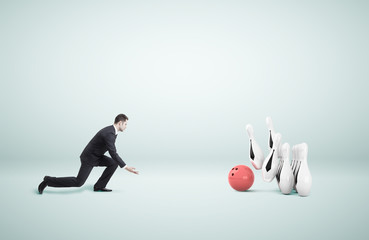 businessman playing bowling