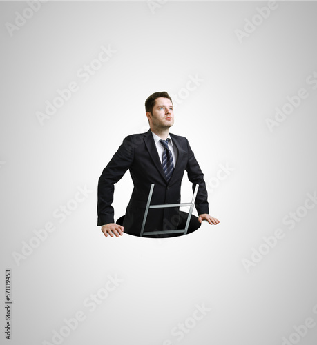 Businessman in hole