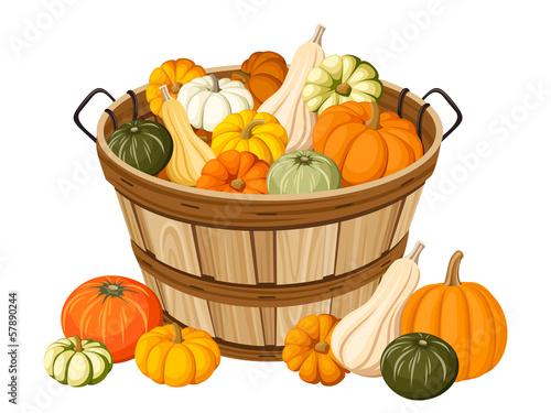 Wooden basket with pumpkins. Vector illustration.