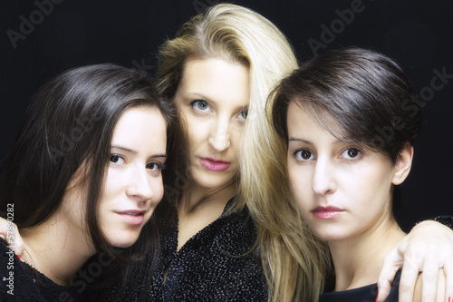 Three young beautiful friends women portrait color image