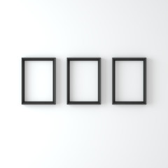 Empty frames on a white wall