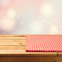 Christmas festive bokeh background with empty wooden table