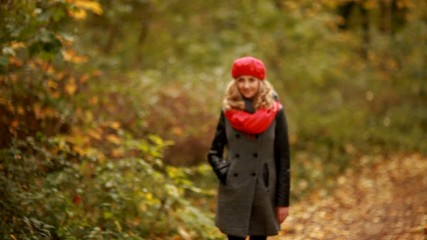 Portrait of beautiful blond woman in forest