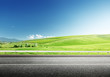 asphalt road and perfect green field - 57892423