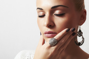 beautiful blond woman.Jewelry and Beauty.liquid sand manicure