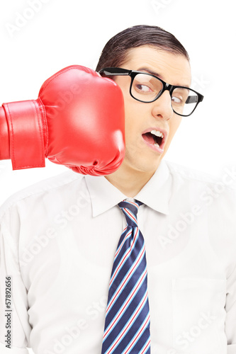 Young man punched by a red boxing glove