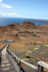Wooden steps lead to the top of a barren rock in the Galapagos