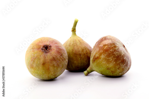 Fresh ripe figs isolated on white background
