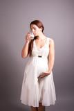 pregnant woman drinking milk