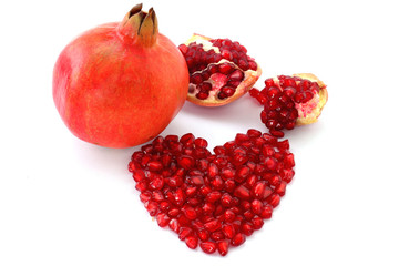 Pomegranate and seeds arranged in heart shape