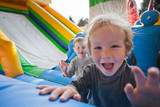 joyful children who jumps on a big inflatable trampoline