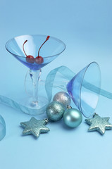 Festive Christmas martini cocktali glasses on blue background