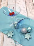 Festive blue martini cocktai glasses on shabby chic
