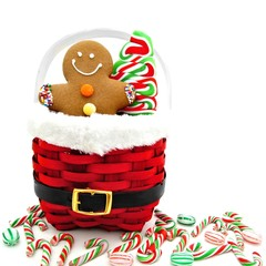 Gingerbread Man and Christmas candy in a red basket