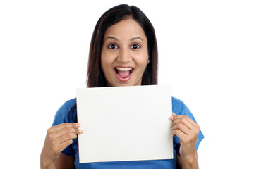Excited young woman showing blank white card