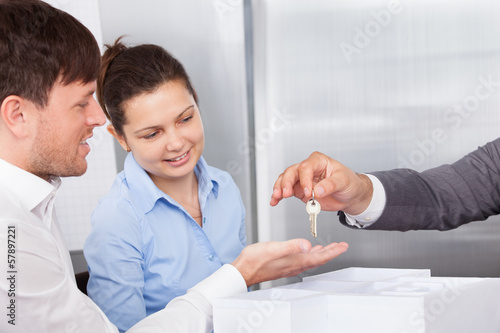 Person Giving Keys To Man