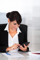 Businesswoman Working With Calculator