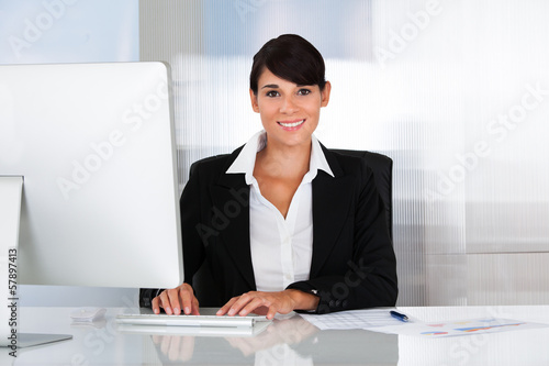 Happy Business Woman Working On Computer