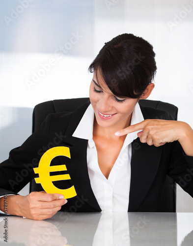 Hand Holding Euro Sign