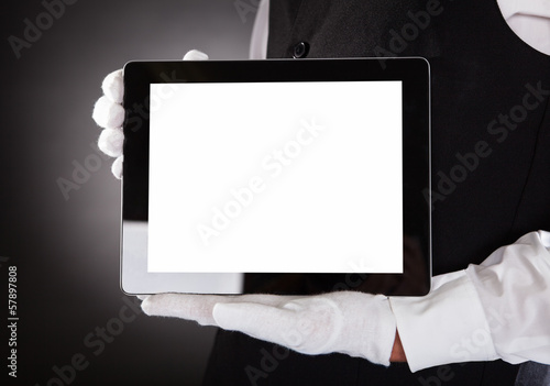 Waiter Holding Digital Tablet