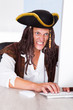 Angry Pirate Using Computer