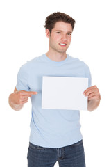 Happy Young Man Holding Blank Placard