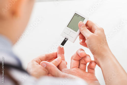 Doctor Checking Sugar Level Of Patient