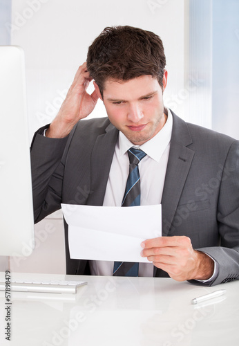 Businessman Holding Paper