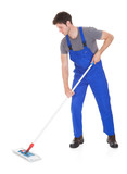 Young Man Cleaning With Mop