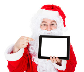 Portrait of santa pointing at digital tablet