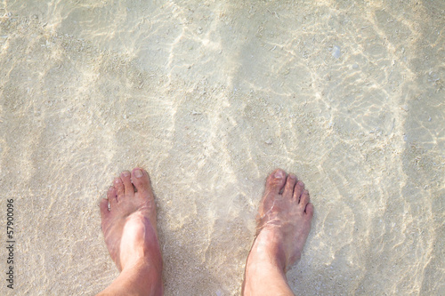 foot on the sandy beach