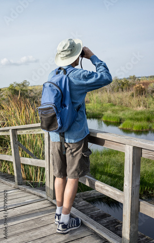 Man Birdwatching in Florida Wetlands