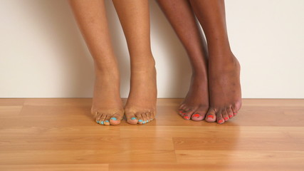 Close up of two women's bare feet dancing