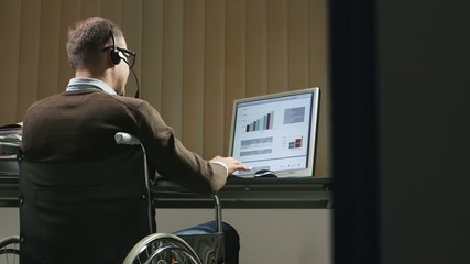 disabled operator on the phone in call center