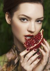 Girl & pomegranate