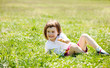 three year old child playing at grass